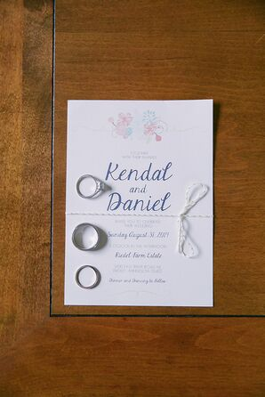 Wedding Rings Resting on Custom Made Wedding Invitations