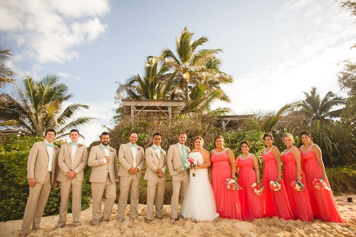 c53e82e5a6 Veronica and Tim stood with their wedding party at the sandy beach in Oahu,  Hawaii