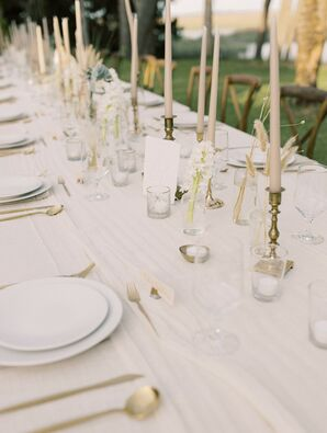 Ethereal Tablescape with White Plates and Gold Candlesticks