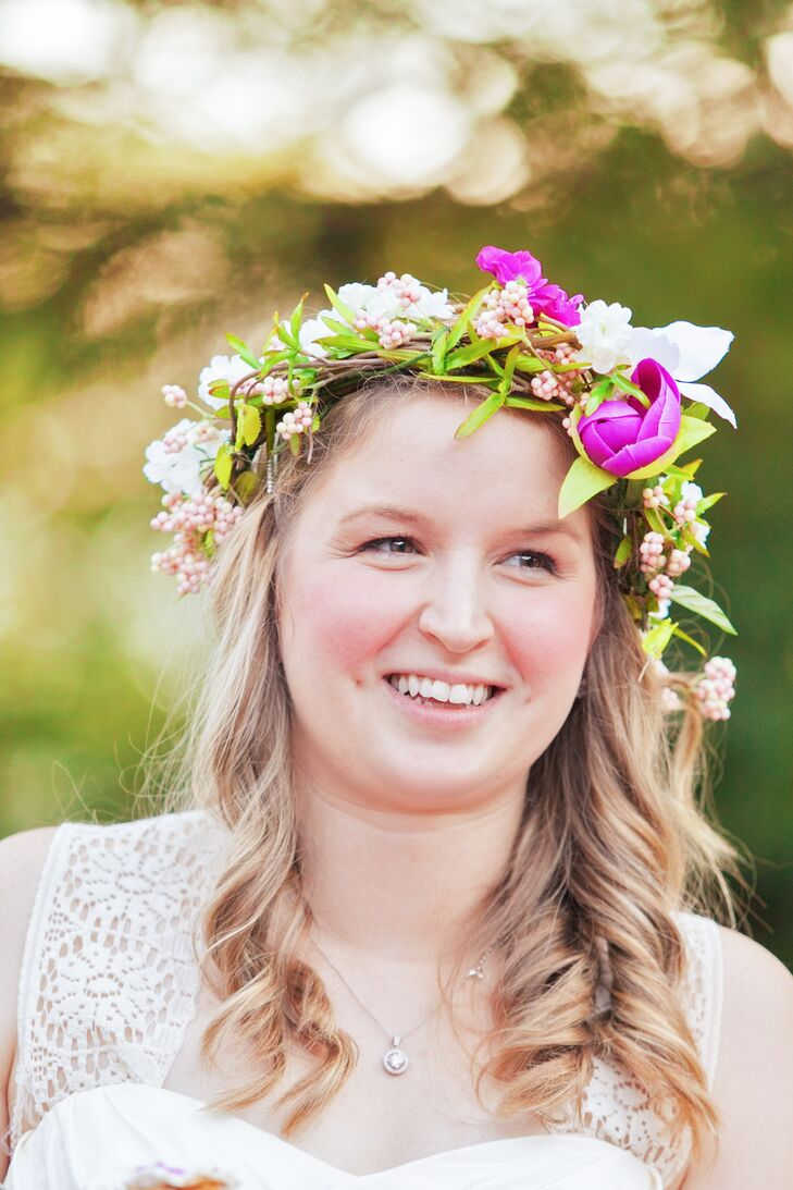 Edith wore her hair down in soft curls with a fresh flower crown she made to complete her relaxed, bohemian look.