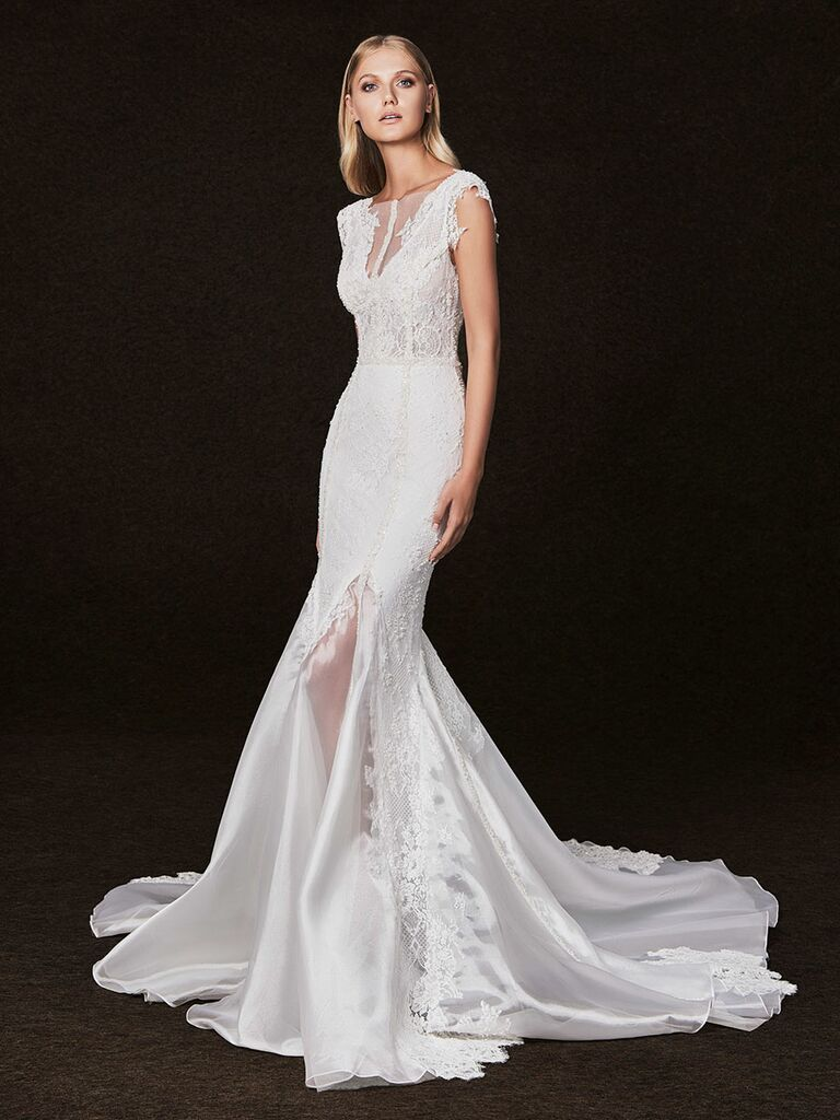 Victoria Kyriakides Fall 2017 v-neck fit-and-flare wedding dress with lace applique and front side slit with sheer fabric detailing