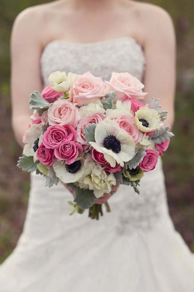 Emily carried pink roses, white anemones, white hydrangeas and mint lamb's ear in her bouquet. The bride wanted all the flowers to look soft and natural for her classic wedding.