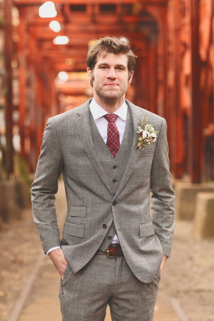 Peter wore a slim-fit gray glen plaid suit from J.Crew.