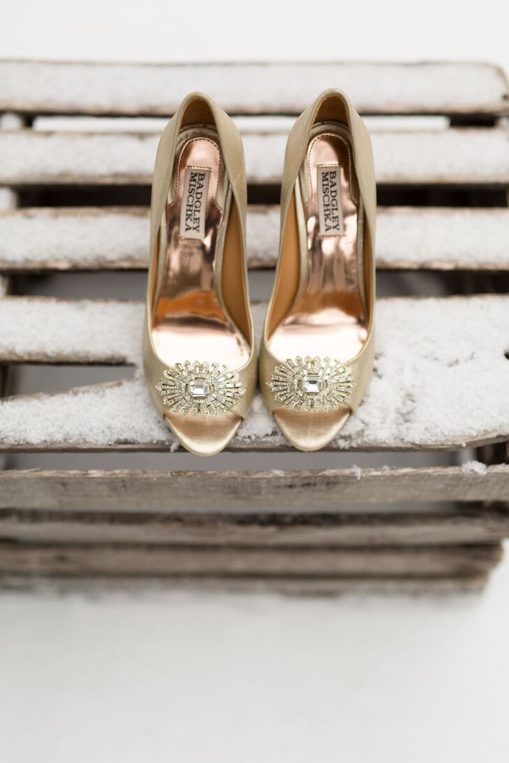 Emily completed her timeless look with champagne-colored Badgley Mischka peep-toe heels. She loved the starburst-style broach on the toe for a little pop of glamour.