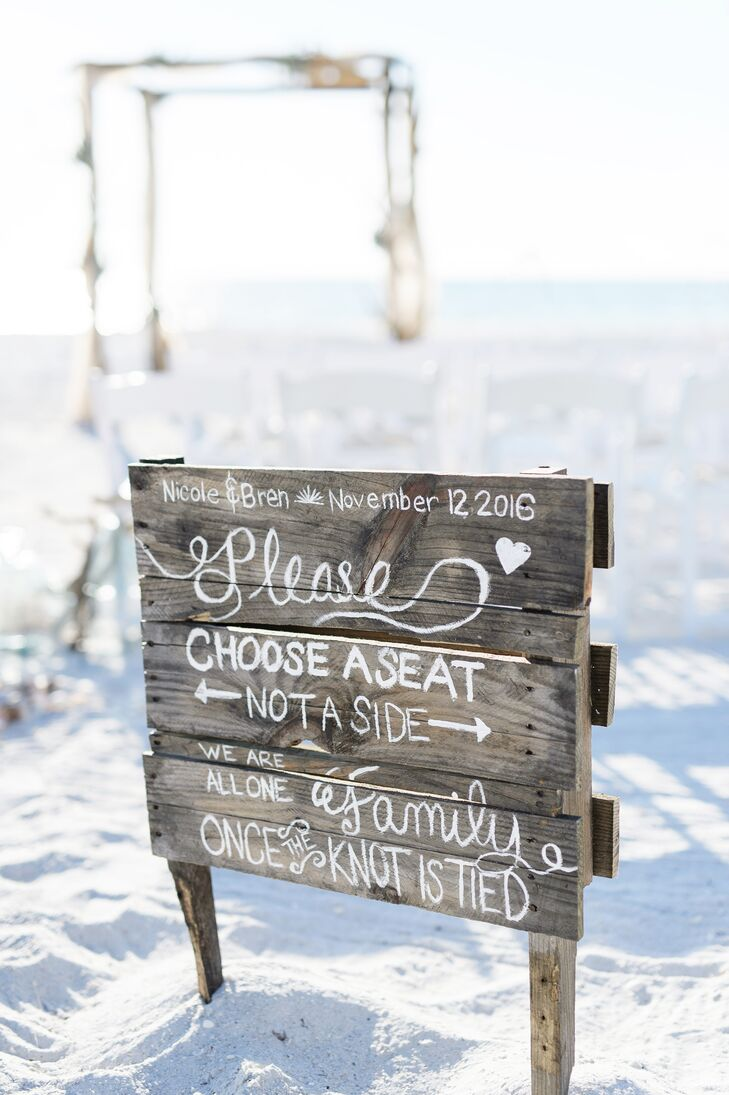 Nicole and Bren encouraged their friends and family members to mix and mingle during the ceremony, with a rustic wooden sign placed at the entrance to the aisle.
