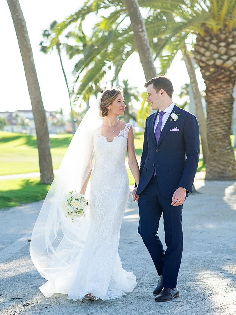 classic lace wedding dress and navy blue suit