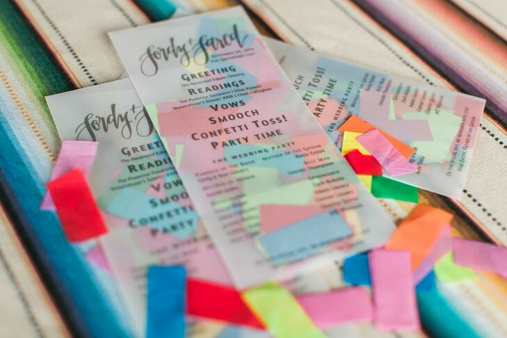 Jordy designed the ceremony programs herself, which were printed on velum envelopes stuffed with oversize confetti. Guests tossed the colorful confetti at the couple during the recessional.