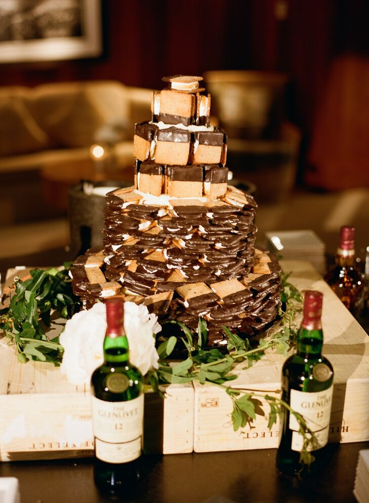 "Because of a last-minute cake mishaps, Katie and Cody had to get creative. ""One of our favorite bakeries in Jackson makes wonderfully delicious homemade s'mores, so we bought 100 of them and had the Amangani Resort stack them into a cake formation."""