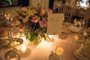 Pastel Floral Centerpiece on a Gold Dining Table