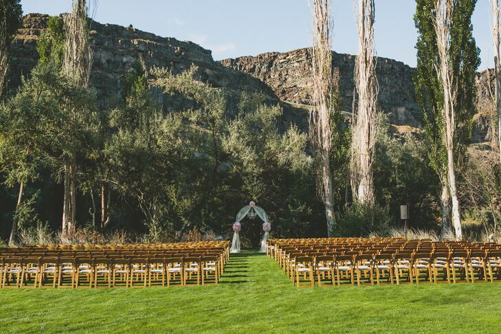The red rocks in the background accented the outdoor ceremony where Elle and Kalen were married under an archway. It was decorated with blush and ivory flowers and a chandelier.