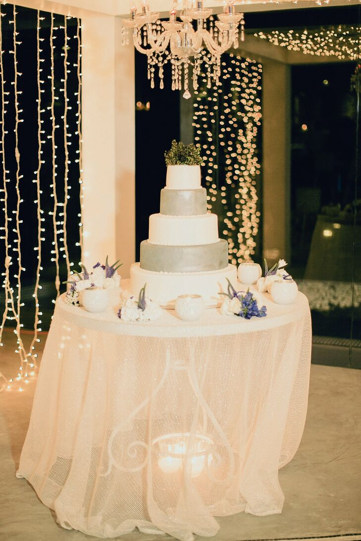 Miriam and Bassel's cake alternated between classic white and metallic silver.