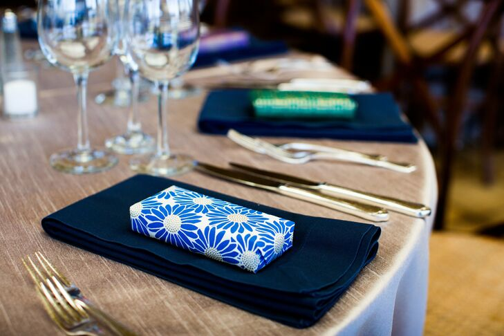 The favors were wrapped in colorful paper and placed on the napkins at each place setting.