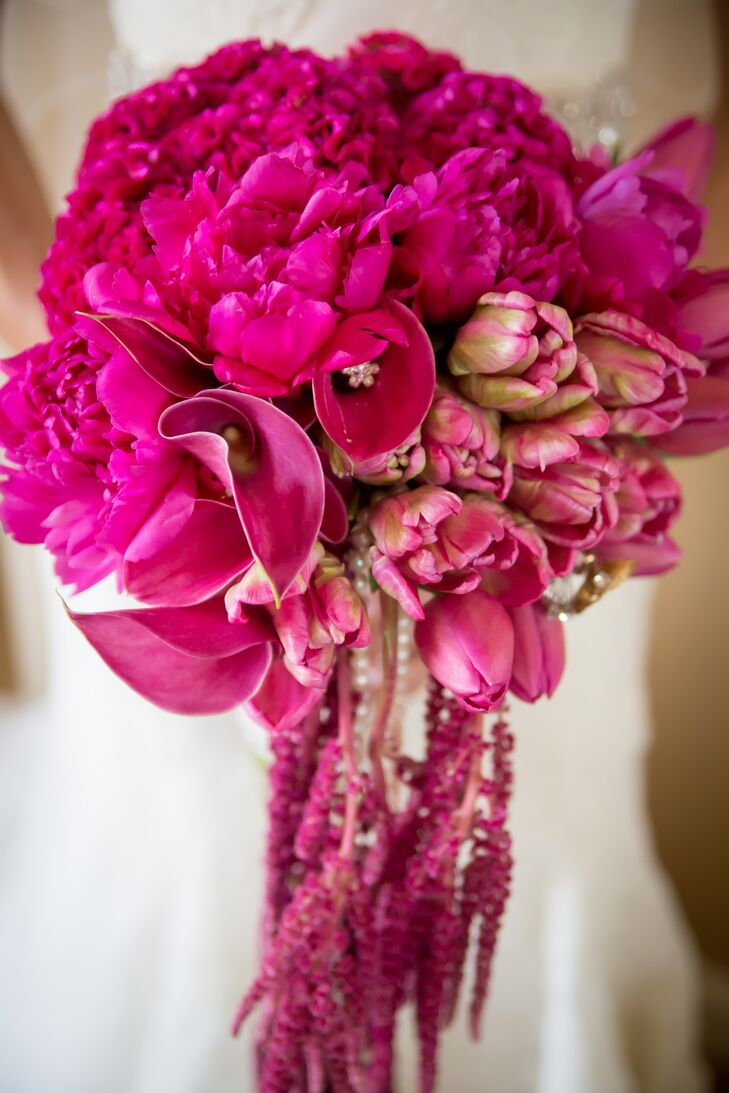 Emily carried a statement bouquet made from vibrant pink peonies, call lilies and dripping amaranthus.