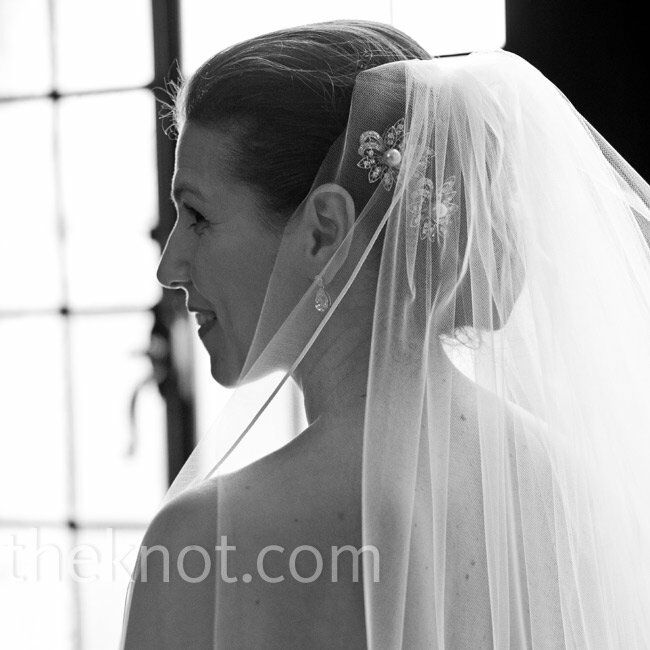 Cindy wore a long, simple veil tucked into her updo.