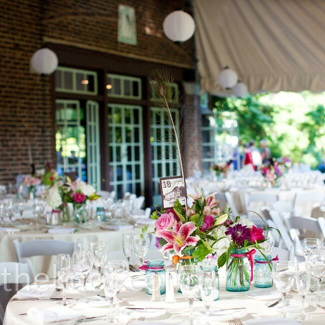 Guests ate dinner on a covered patio at the Greenville Country Club. The linens and place settings were simple, allowing the centerpieces to stand out.
