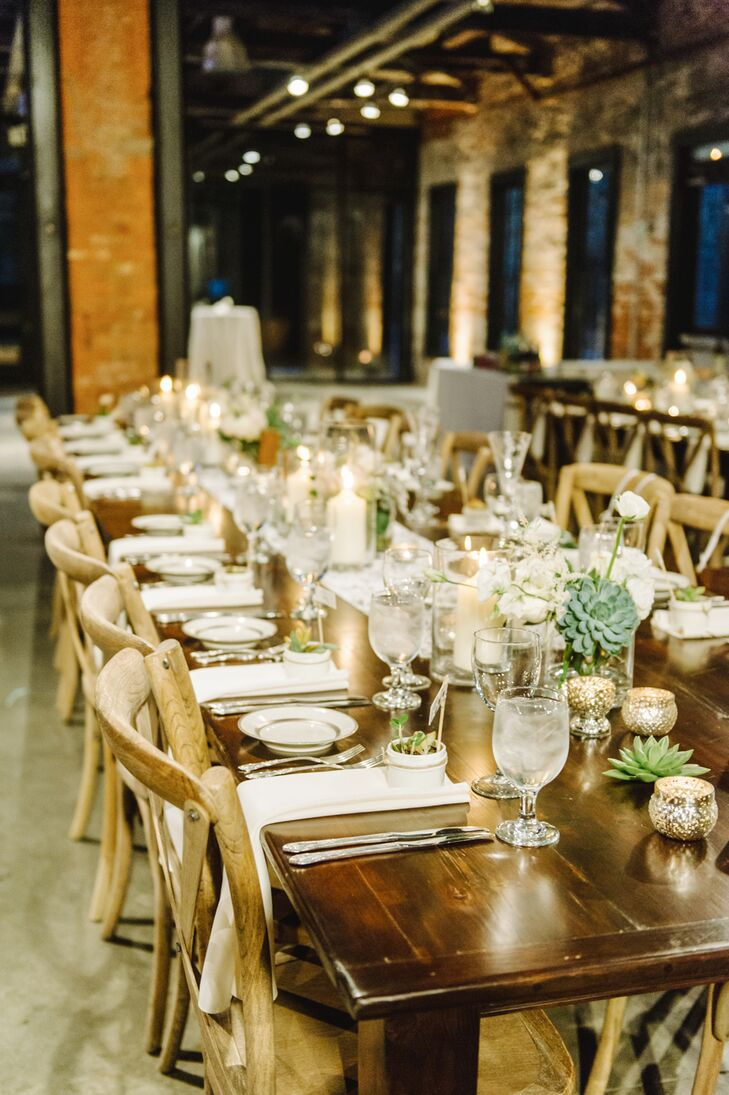 The reception took place inside the Mount Washington Mill Dye House, where guests took their seats at long wooden farm tables decorated with succulents and candles.
