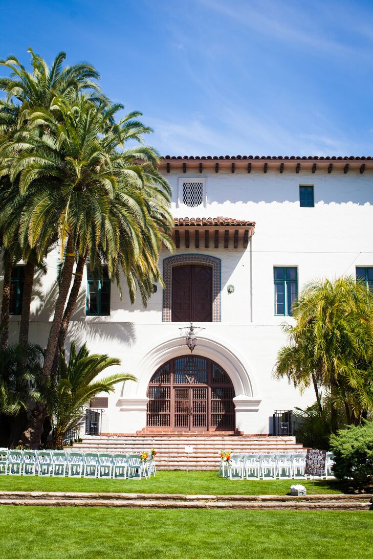 """The couple said """"I do"""" in the sunken garden of the Santa Barbara County Courthouse. Guests looked on from simple, white chairs while Sarah and Joshua sealed the deal under a pair of palm trees."""