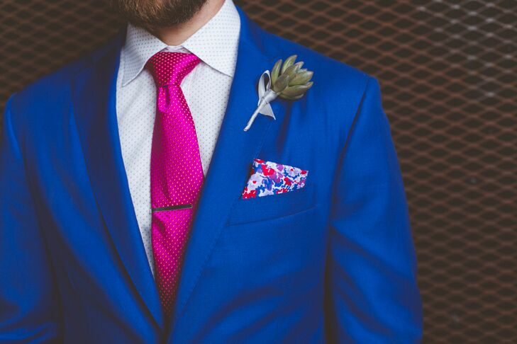 Dobi wore a custom blue suit made by Gus Karim at Gassane Tailors. He chose the fabric, custom liner and detailing himself! A brightly patterned pocket square, hot pink tie and succulent boutonniere completed his whimsical style.