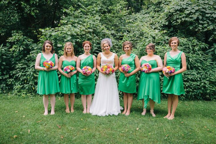 "Jodi's six bridesmaids also wore dresses from David's Bridal. ""They could choose whatever style they liked best, as long as the dress was Kelly green and short,"" she says. ""Half of the bridesmaids chose chiffon fabric, and half chose satin."""
