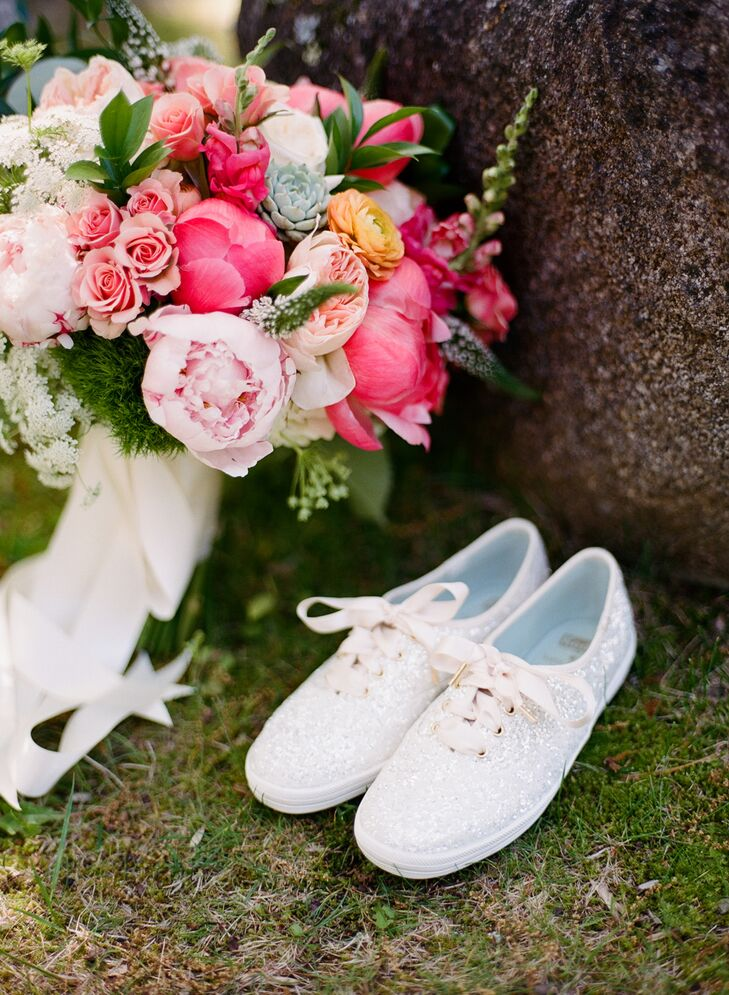 """During the ceremony, Jamie accessorized her Romona Keveza gown with a pair of Badgley Mischka shoes, then switched into a pair of white glittery Kate Spade Keds for the reception. """"I am the biggest Kate Spade fan, so I had to make sure to incorporate her some how,"""" Jamie says."""