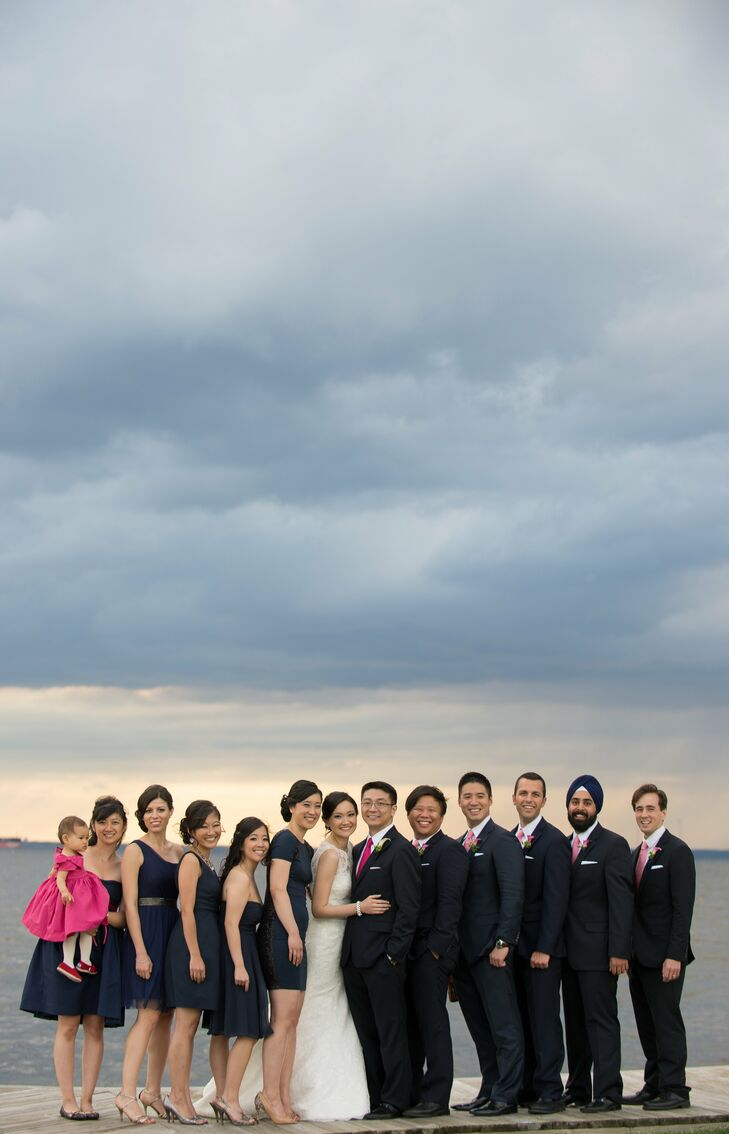 Steve let the groomsmen choose their own navy blue suits from Nordstrom. He bought each of them a pink tie and white pocket square to tie into the wedding colors.