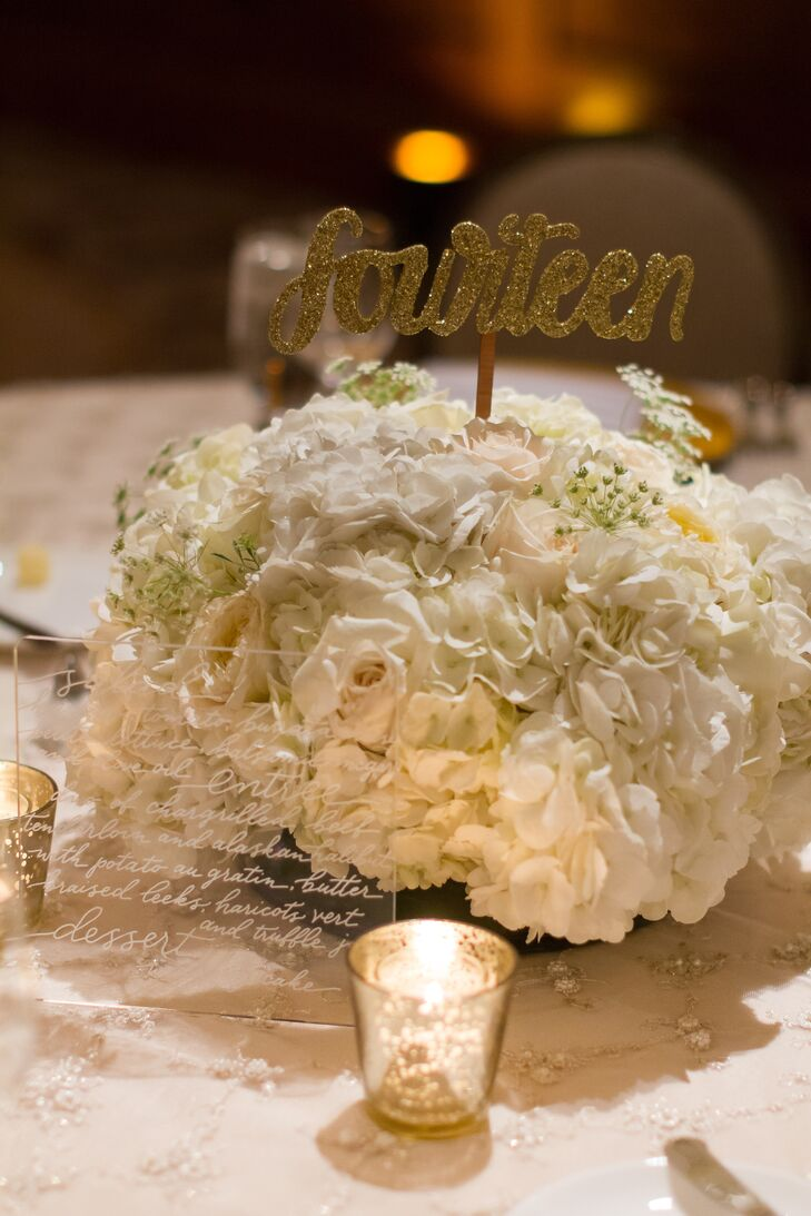 Some of the reception tables were topped with low centerpieces of ivory hydrangeas and amber votives.
