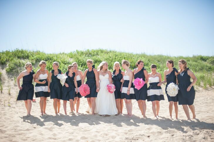 """With so many bridesmaids, Katey wanted to get creative and had them carry colorful patterned boxes and or large paper flowers instead of fresh flower bouquets. """"The boxes were fun because they added a sense of surprise to the ceremony as guests wondered what was in them,"""" says Katey. """"Inside were various wishes Matt and I wrote for each other and our future—some were funny others more sentimental, but it was an unexpected added element to our ceremony."""""""