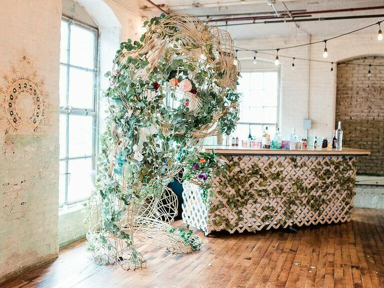 Vintage bar with trellis covered in ivy with greenery installation