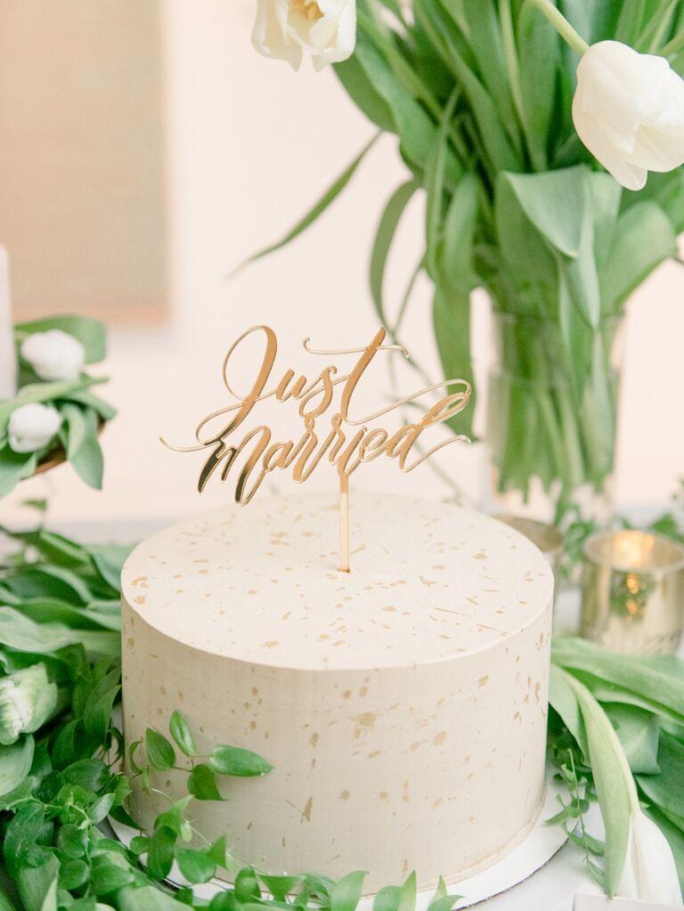 Simple one-tier wedding cake with gold flecks