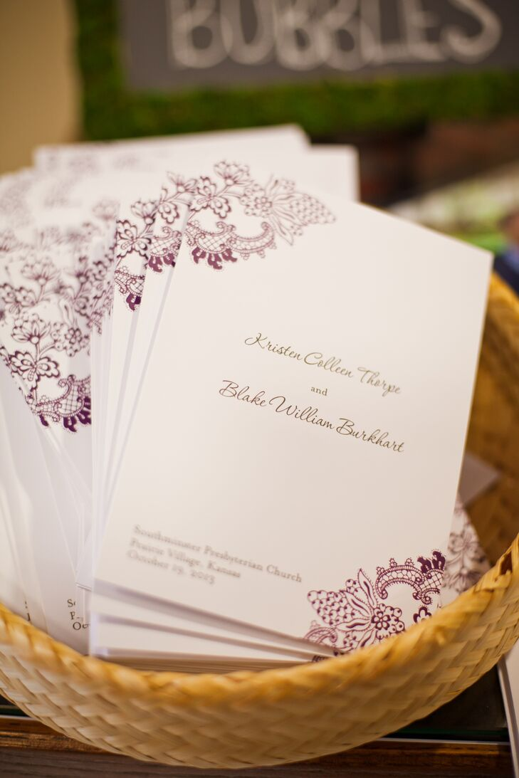 The ivory programs had an elegant damask design printed in aubergine ink.