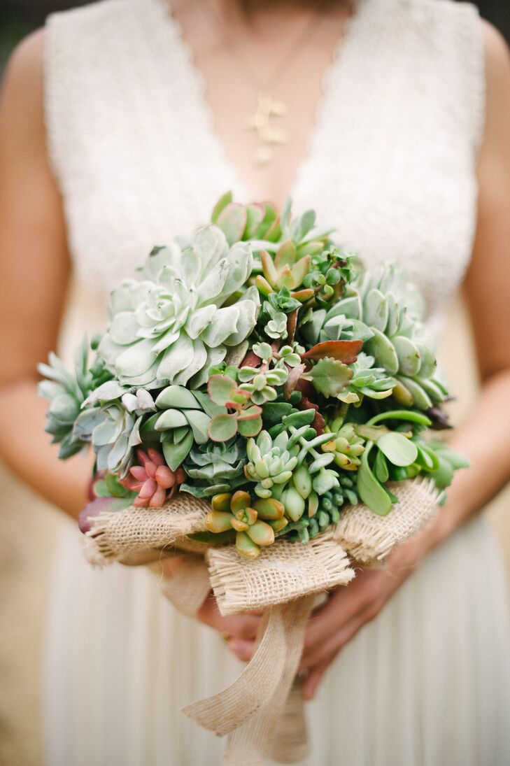 Succulent accents throughout contributed to the rustic theme, including Emily's bridal bouquet, which was filled entirely with green succulents. The bouquet was tied at the bottom with burlap ribbon.