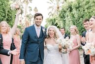"Audrey Wayne and Max Riccio love the ""mid-century charm"" of Palm Springs, so they got married at The Frederick Loewe Estate. ""The view, the architectu"