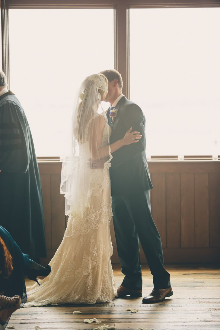 Kristin wore a Martina Lianna wedding dress. She knew she wanted a dress with a low back that was still tasteful. Plus, she adored the tiered lace on the skirt. She completed her look with her mother's veil.