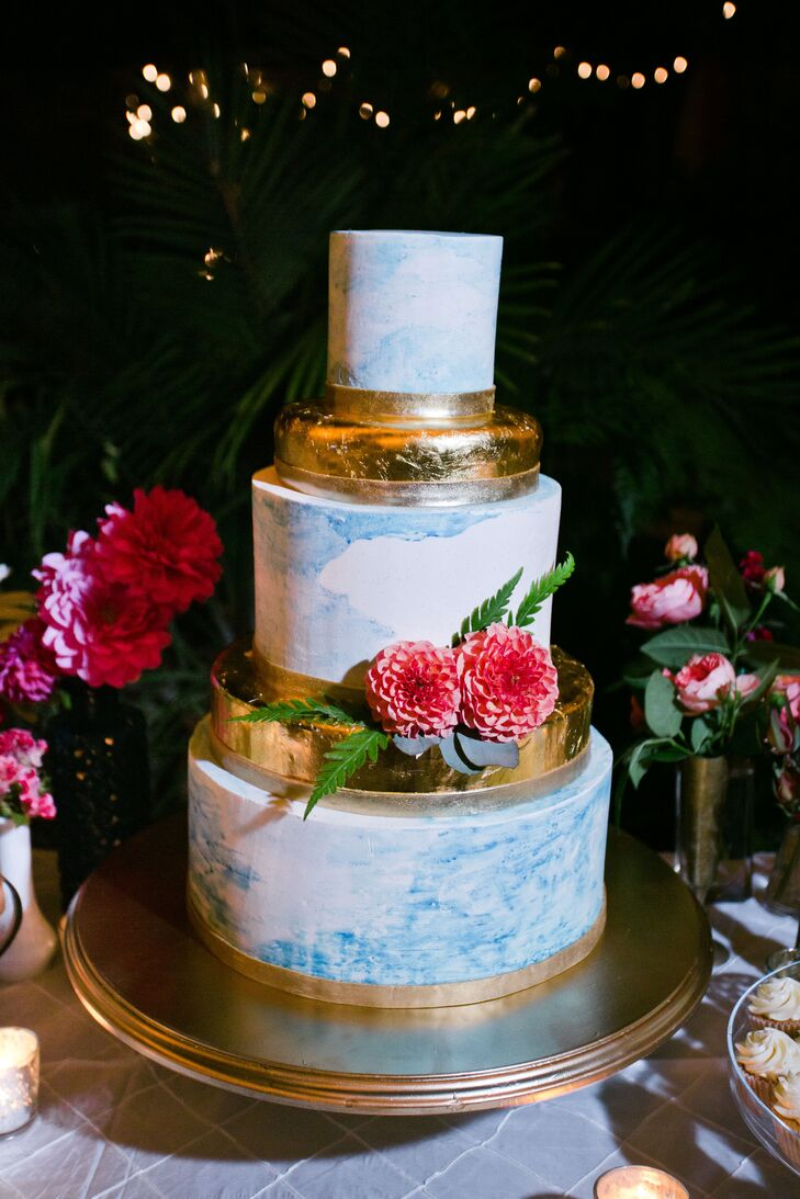 In keeping with South African tradition, Mallory and Richie had a layer of fruit cake nestled between the chocolate and vanilla. Gold ribbon and bright flowers served as accents.