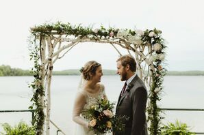 Casually Elegant Couple In Front of Birch Ceremony Arch with Romantic Flowers and Greenery