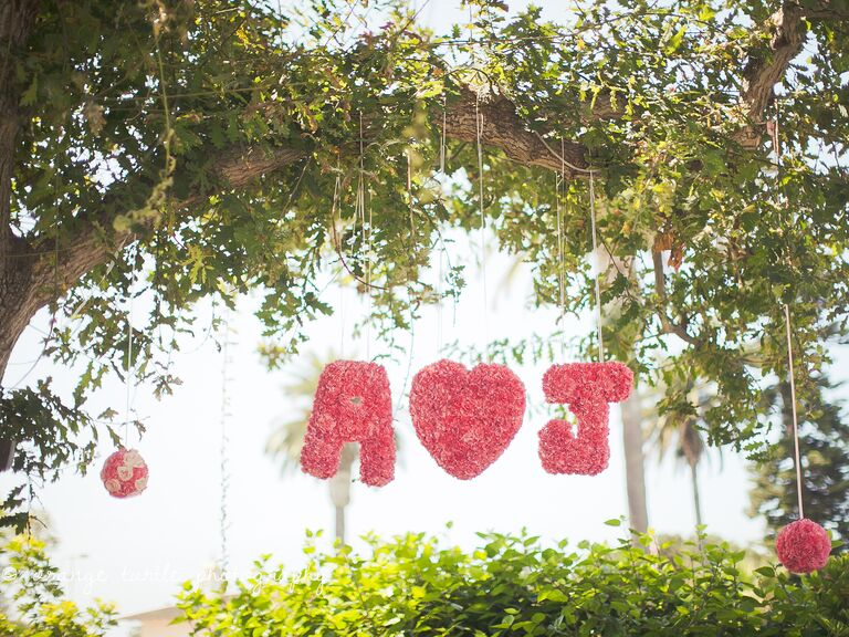 Hanging floral monogram at wedding reception