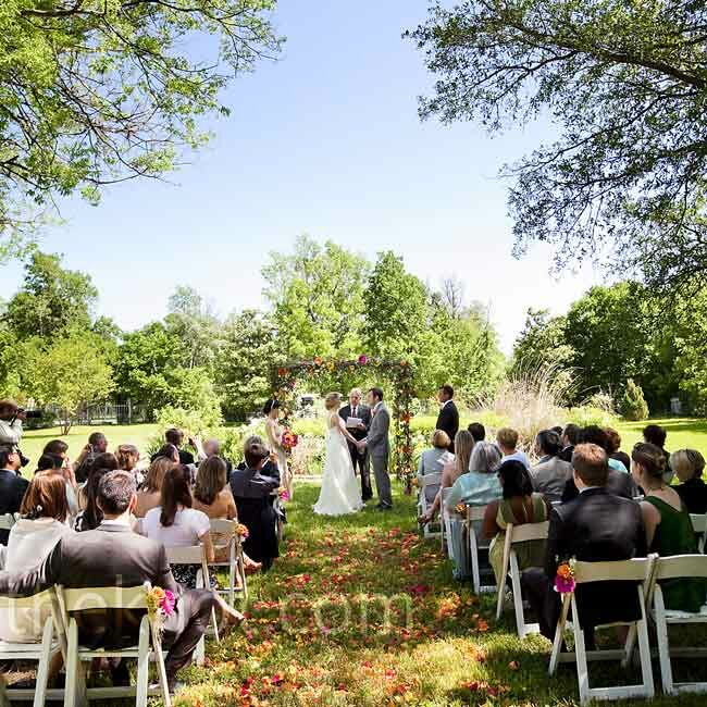 It was a sunny, breezy day for their morning ceremony on the lawn. Deborah walked down an aisle of colorful rose petals to an arch decorated in the same flowers.