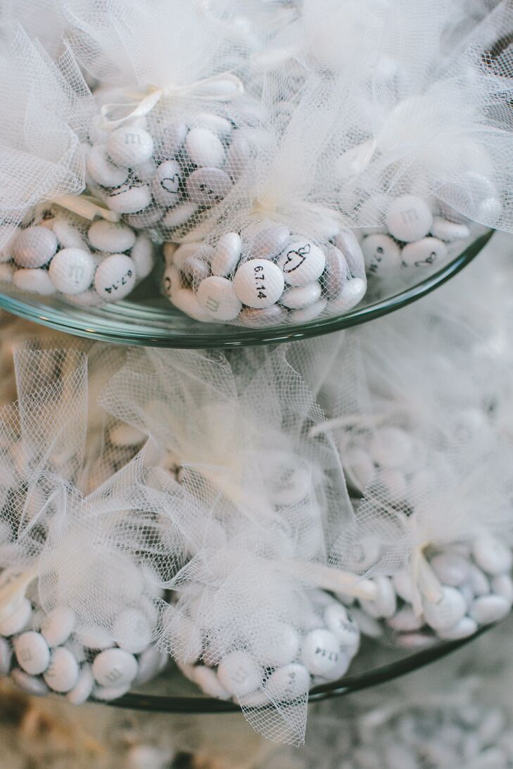 At the end of the evening, Kaleigh and Jeff sent their guests home with a few sweet treats, white M&Ms boasting their wedding date in whimsical white tulle sachets.rn