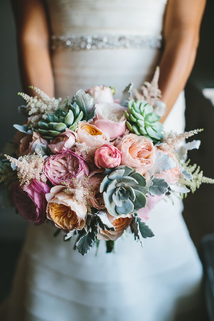 """I knew I didn't want anything resembling a traditional bouquet, but I also didn't want long pieces of greenery flowing out of it,"" Jordan says of her pale peach and pink arrangement by Laura Jean Floral and Design. ""It had wonderful pops of color and accent pieces."""