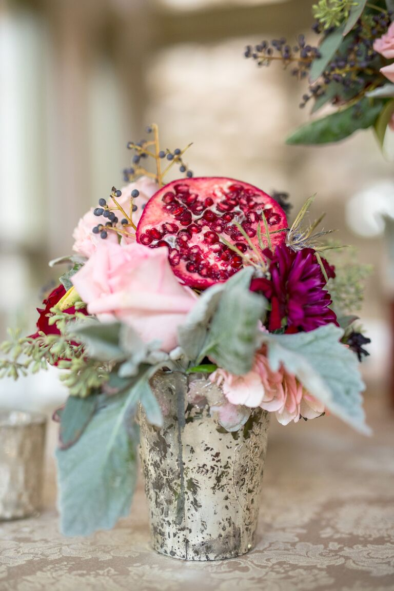 Fresh pink and purple flower and pomegranate centerpiece arrangement
