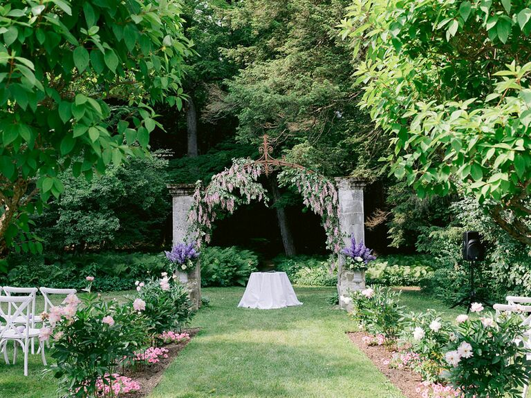 Whimsical garden wedding with airy pastel flowers and greenery