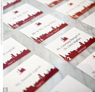 For a playful look, Carrie and Rob had their escort cards printed with the same city skyline motif used on their other stationery.