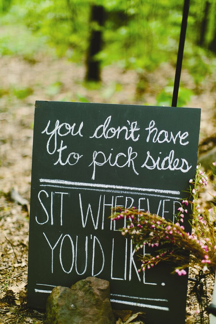 A chalkboard sign at the ceremony let guests know they could sit wherever they liked.