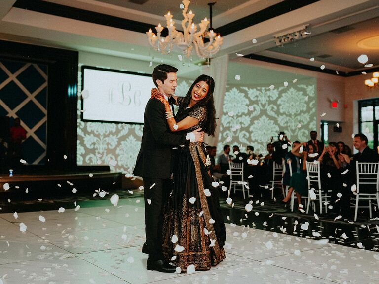 couple dancing at wedding in sari and tux