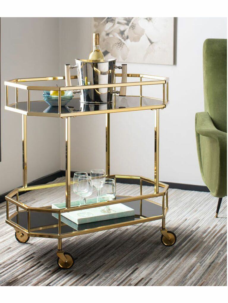 Vintage bar cart with gold hardware and black glass