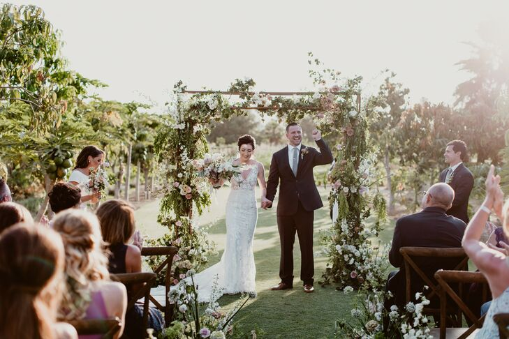 TaylorBuckler and Cody Ayers opted for simple décor to highlight Flora Farms's natural beauty, relying heavily on dusty pink candles and romantic flo