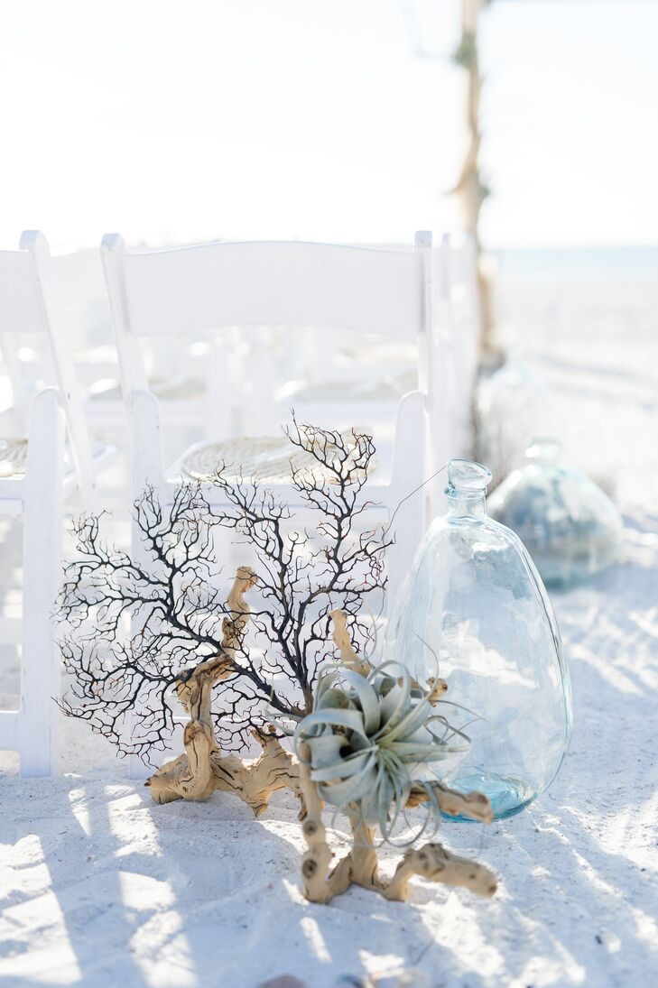 While the soft white sand and sparkling waters of Marco Island were enough to make guests swoon, Nicole and Bren amped up the island getaway effect by lining the aisle with driftwood, sea fans, air plants and pale blue blown glass vases.