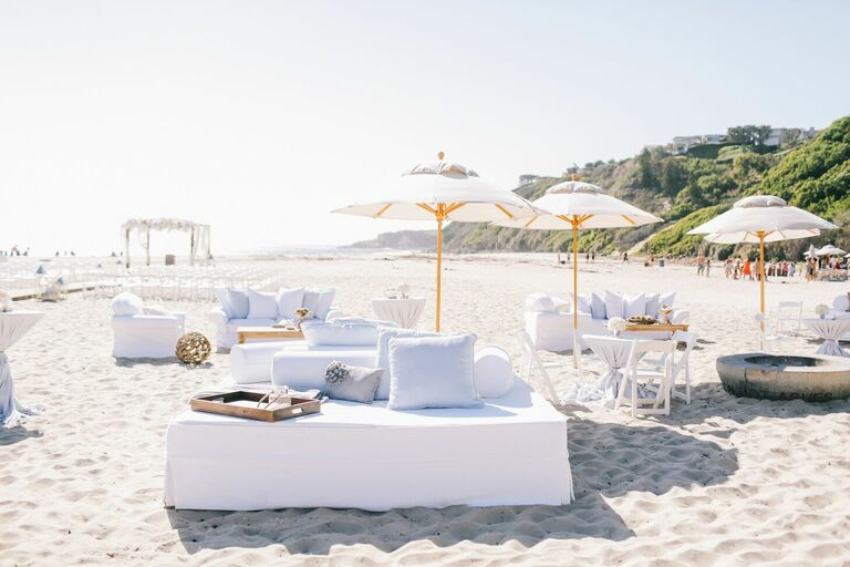 White lounge furniture and umbrellas on beach
