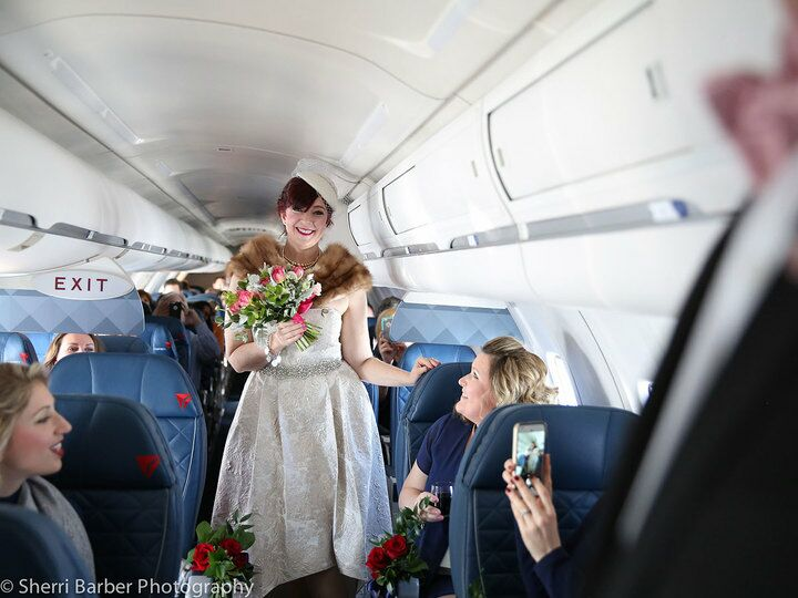 bride walks down plane aisle
