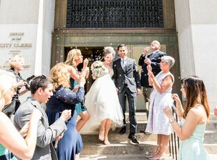 Cali O'Rourke (28 and an HR consultant and a wedding calligrapher) and John Wu (29 and a managing consultant) planned an intimate City Hall affair for